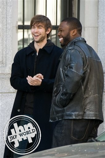 "Curtis ""50 Cent"" Jackson and Chace Crawford laugh between takes on the set of ""Twelve"", Monday, April 27, 2009, in New York. (AP Photo/Charles Sykes)"
